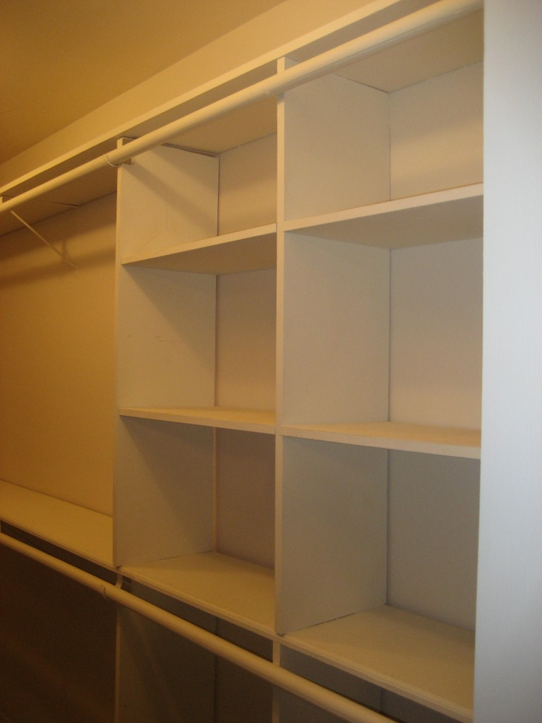 closet with rod going across built-in cubbies