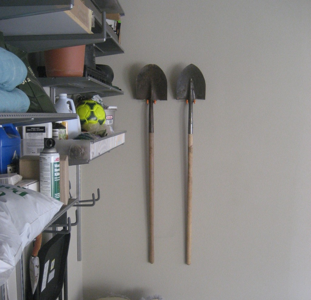 garden shovels on wall