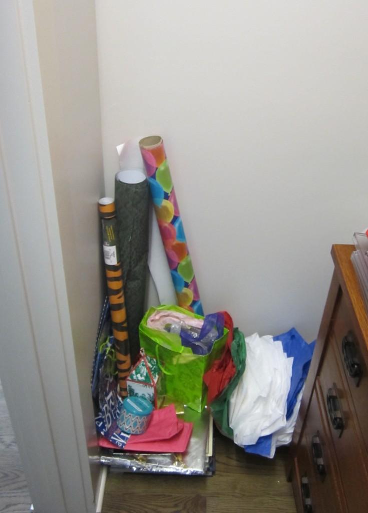 gift wrap on floor of closet www.ajonesfororganizing.com