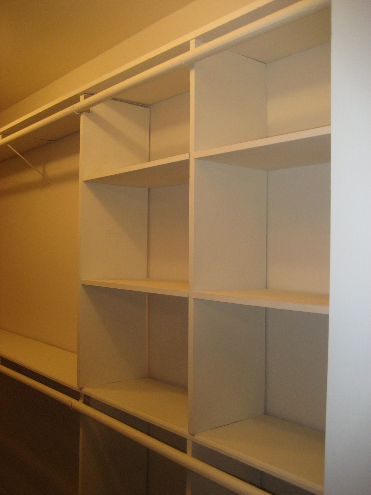 Closet With Rod Going Across Built In Cubbies
